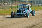 This square top with its three-carburetor Cadillac OHV V-8 engine raced at the old Keene, NH Fairgrounds dirt track. It was restored by Pete vonSneidern and Jim Martel. The photo shows the car and its driver, Don Lawler, behind the wheel at the remnants of the Keene track. Lawler was nearly 90-years young when the photo was taken.