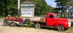The fairgrounds in Safford, NH, was the scene of Big Car, midget and stock car races for decades. This car and truck, both owned by Board Member Pete vonSneidern, make an appropriate pair as they are photographed at the track entrance. The car is powered by a four-cylinder engine that was typical of the day. It was one of two Granite State Auto Body Specials and was driven by Art Rousseau.