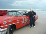 Russ Truelove raced this very car on the Daytona beach-road course, barrel rolling it a half-dozen times. Pictures of the crash were published widely at the time. Truelove has restored the car and is shown on the sands of Daytona where for a few hours on one day each year the highway and the beach are closed to regular traffic. Race cars, including Russ and his big old NASCAR machine, tour the same route that was taken during the pre-1959 beach-road racing days.